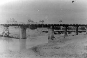 Image: Oakey Creek Bridges c.1943 Source: Dpt. of Defence Railway bridge (foreground) and the old wooden road bridge behind