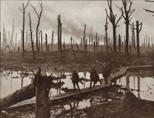 Image: Soldiers of an Australian 4th Division field artillery brigade on a duckboard track passing through Chateau Wood, near Hooge in the Ypres salient, 29 October 1917. The leading soldier is Gunner James Fulton and the second soldier is Lieutenant Anthony Devine. The men belong to a battery of the 10th Field Artillery Brigade.  Source: By Frank Hurley - This image is available from the Collection Database of the Australian War Memorial under the ID Number: E01220